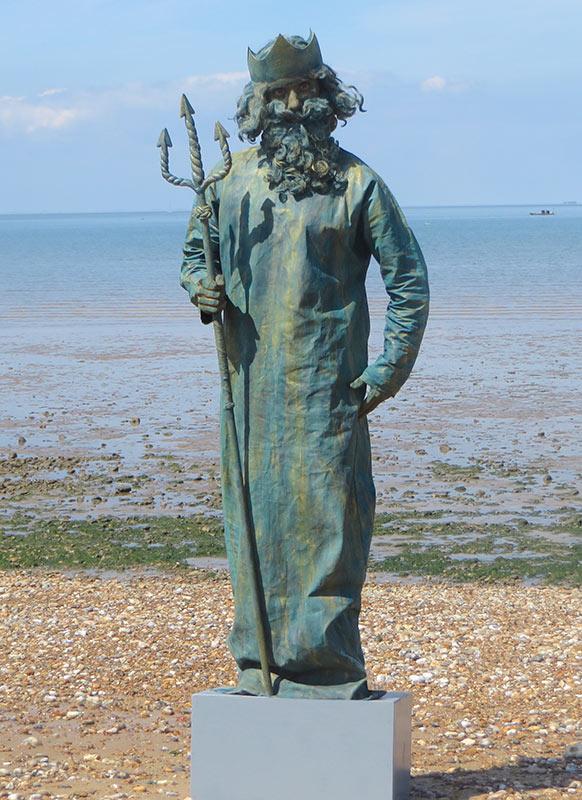 Neptune Statue Mime Act